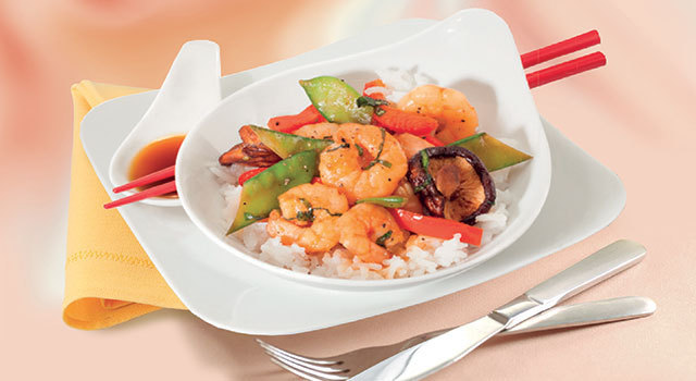 Wok épicé de crevettes et légumes